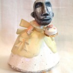 . papier-mâché, acrylic paint and found ceramic figurine
